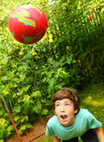 Boy playing with ball training soccer head blow Stock Photo