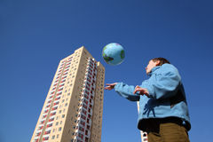 Boy playing with balloon in form of globe Royalty Free Stock Photography