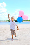 Boy playing with  balloons Stock Image