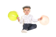 Boy playing with balloons royalty free stock photos