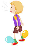 Boy playing balloons popping Royalty Free Stock Photography