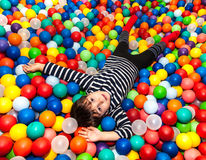 Boy playing with balls Royalty Free Stock Image