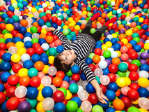 Boy playing with balls Stock Photography