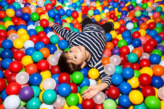 Boy playing with balls Royalty Free Stock Photo