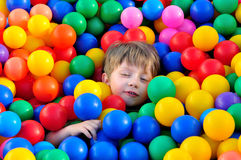 Boy playing with balls. stock photos