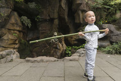 Boy playing bamboo pole Royalty Free Stock Photography