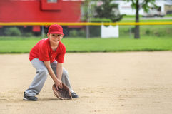 Boy playing baseball Royalty Free Stock Images