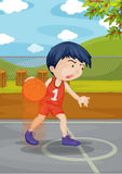 A Boy Playing Basket Ball Stock Images