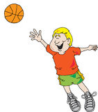 Boy Playing Basketball. Image of a boy taking a shot with a basketball Stock Photography
