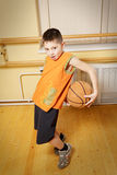 Boy playing basketball. In gym Royalty Free Stock Photography