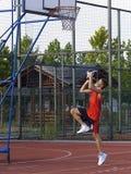 Boy playing basketball. Jump and shot Royalty Free Stock Photography