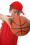 Boy playing basketball. A young active boy playing with a basketball Stock Image