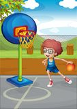 A boy playing basketball royalty free illustration
