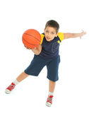 Boy playing basketball isolated Royalty Free Stock Images