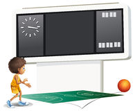 A boy playing basketball with a scoreboard Royalty Free Stock Image