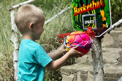 Boy playing basketball. Young boy playing basketball in the nature Stock Photo