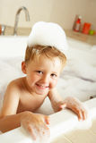 Boy Playing In Bath Stock Images