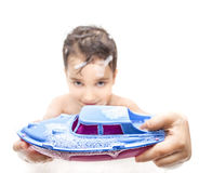 Boy playing in the bath with a toy boat Royalty Free Stock Photo