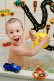 Boy playing in the bathroom Royalty Free Stock Image