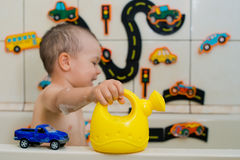 Boy playing in the bathroom Stock Images