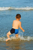 Boy playing on beach Stock Photo