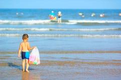 Boy playing on beach Stock Image