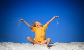Boy playing on beach Stock Image