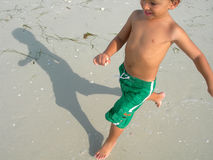 Boy playing on beach Stock Photos