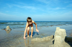 Boy playing on the beach Stock Photography