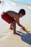 Boy Playing At Beach Royalty Free Stock Photos