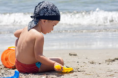 Boy playing on beach Royalty Free Stock Image