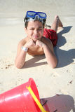 Boy Playing At Beach Stock Photos
