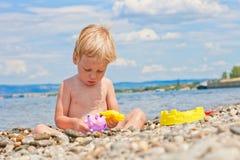 Boy playing on the beach Stock Photos