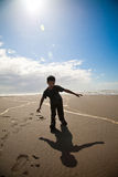 Boy playing on beach royalty free stock photos