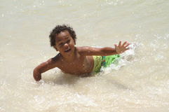 Boy Playing on beach Stock Photos