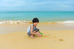 Boy playing on the beach Stock Photo