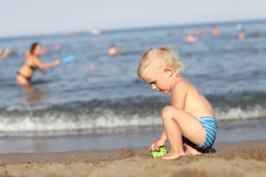 Boy playing on beach Royalty Free Stock Images