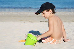 Boy playing in the beach Stock Photos