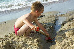 Boy Playing At The Beach Royalty Free Stock Photography