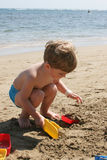 Boy Playing on Beach Stock Images