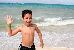Boy Playing At Beach Royalty Free Stock Photo