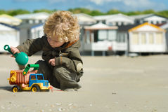 Boy playing on the beach Stock Photos