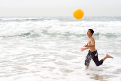 Boy playing beach ball Royalty Free Stock Image