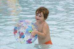 Boy playing with beach ball Stock Images