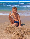 Boy playing on the beach Royalty Free Stock Image