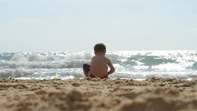Boy playing on the beach Royalty Free Stock Photography