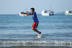 Boy playing on beach series Royalty Free Stock Photo