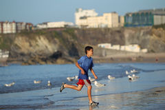 Boy playing on beach series Royalty Free Stock Photography