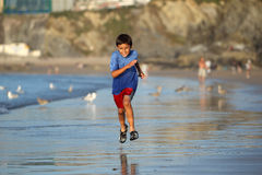 Boy playing on beach series Royalty Free Stock Photos
