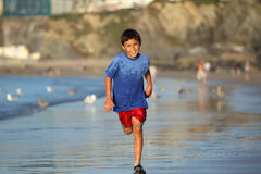 Boy playing on beach series Royalty Free Stock Image